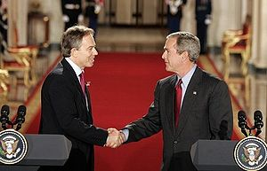 Tony Blair and George W. Bush shake hands